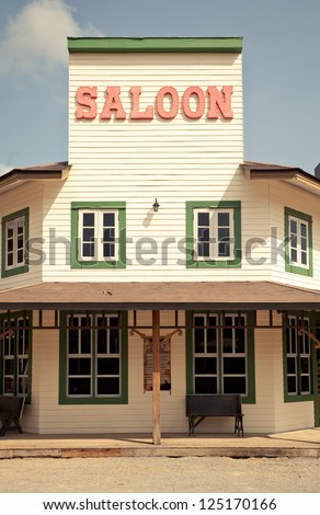 Saloon in Wild West style with blue sky