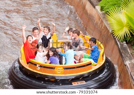 SALOU, SPAIN - APRIL 13: People ride at Theme Park in April 13, 2011 in Salou, Spain.  Grand Canyon Rapids is one of most exhilarating rides in Old American West area at Port Aventura