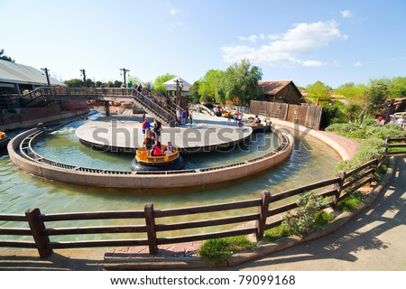 SALOU, SPAIN - APRIL 11: People riding in Theme Park in April 11, 2011 in Salou, Spain.  Grand Canyon Rapids  is one of most exhilarating rides in Old American West area at Port Aventura