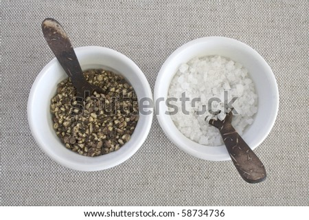 Salt and pepper in white pots