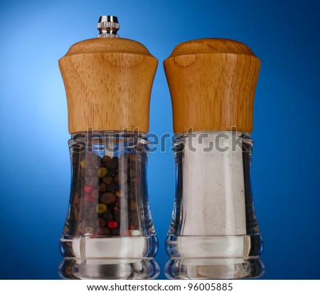 Salt and pepper mills on blue