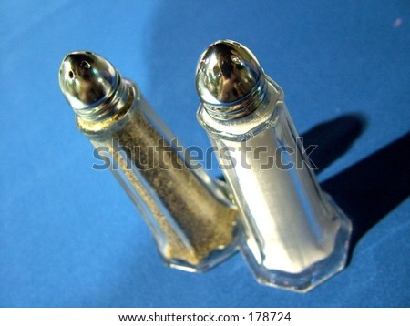 Salt and Pepper shakers against blue tablecloth