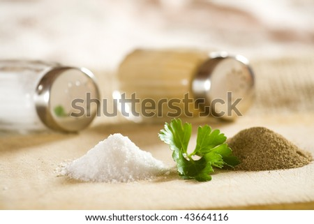 Salt and pepper shakers and small heaps.
