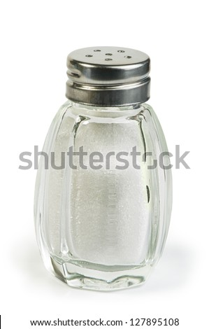 Salt and saltshaker on white background .