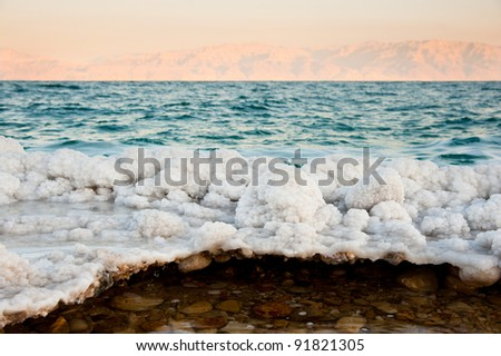Salt-encrusted rocks along the shores of the Dead Sea at Ein Gedi, Israel.