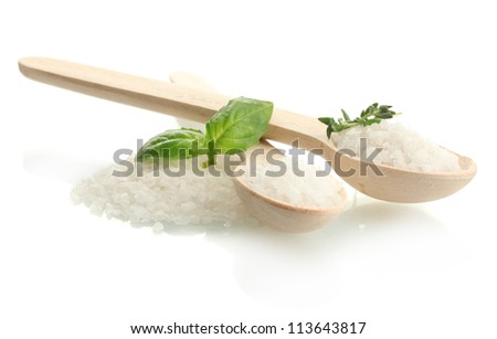 salt in spoons with fresh basil and thyme isolated on white
