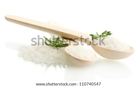 salt in spoons with fresh rosemary and thyme isolated on white