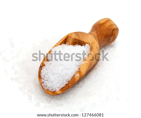 salt in wooden scoop isolated on white background