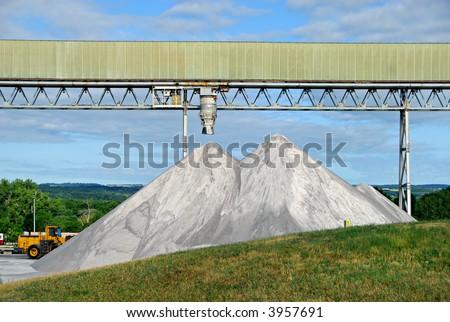 Salt mine, with pile of rock salt for winter roads, waiting for transport