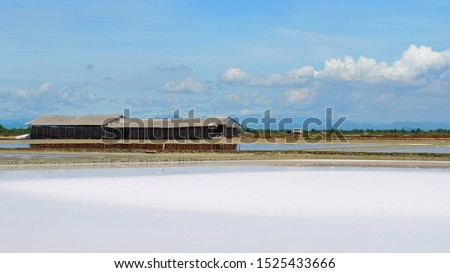 Salt pan and warehouse located at Samutsongkram province during summer time of Thailand,  South East Asia,  Asia.