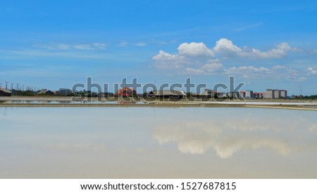 Salt pan located at Samutsongkram province during summer time of Thailand,  South East Asia,  Asia.