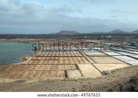 Salt-pans with volcanos in the background, Lanzarote, Canary Islands, Spain