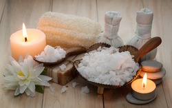 Salt spa and massage  objects over wooden background, wellness and relaxation concept with candle light, low key style
