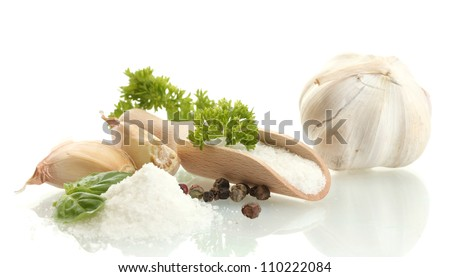 salt with fresh basiland parsley, garlic and pepper isolated on white