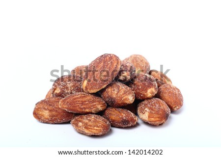 salted and roasted almonds on white background