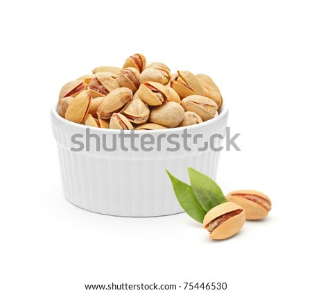 Salted and roasted pistachio nuts isolated on white background