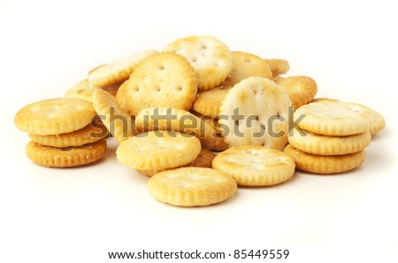salted biscuit stack isolated on white background - stock photo