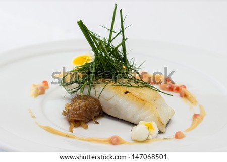 Salted cod brushed, served with caramelized onion quail eggs poached for 2 minutes, butter-wine sauce, caviar and dill