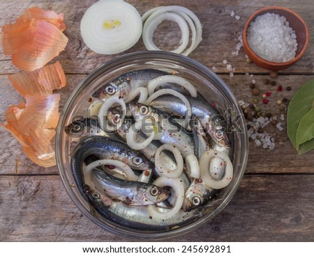 salted fish with spices and onions in a glass bowl #245692891