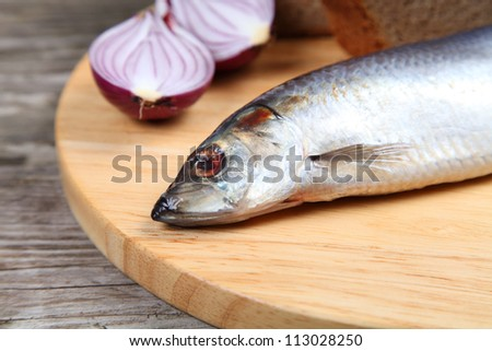 Salted herring on a wooden board