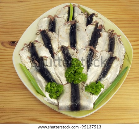 Salted herrings on a wood texture background