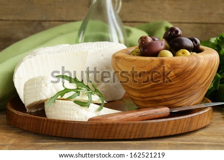 salted milk cheese (feta) and marinated black olives