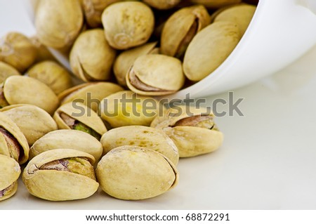 Salted pistachios isolated on white background