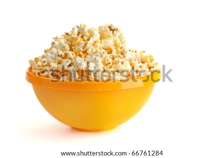 Salted popcorn grains in the yellow bowl