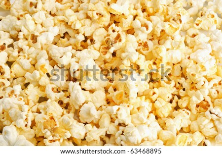 Salted popcorn grains on the white background