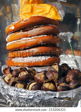 Salted pretzels and freshly roasted chestnuts vendor cart in New York City