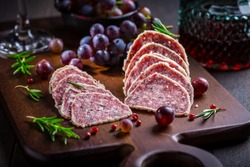 Saltufo - Italian salami delicacy, salami with summer truffle coated with Parmesan cheese with red wine and grapes
