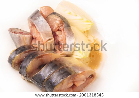 Saltwater fish Mackerel, slightly salted and smoked. spicy, sliced and ready to eat. migratory, surface-dwelling predatory fish of commercial importance as a commercial target ストックフォト ©