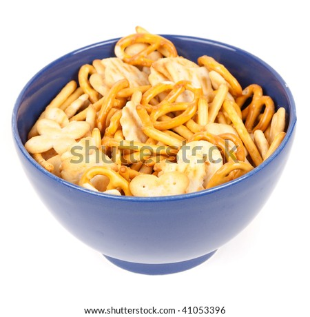 Salty crackers and pretzels on a blue bowl isolated on white background