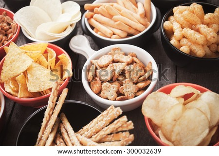 Salty crackers, tortilla chips and other savory snacks with salsa dip Photo stock ©