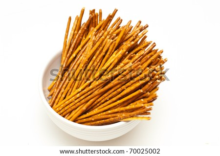Salty pretzel sticks isolated on white background