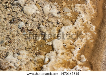 salty sand beach of dead sea shoreline natural background