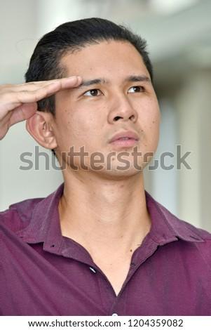Saluting Filipino Male #1204359082