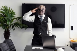 Saluting humanoid Alien in a white shirt and business black suit in a conference, meeting room or home office. Salute gesture. CEO giving Army Salute, standing and looking at camera