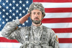 Saluting soldier with national flag of USA on background