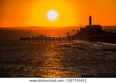 SALVADOR, BRAZIL: Portrait of the Farol da Barra Salvador Brazil lighthouse. Beautiful landscape with verm at sunset. Foto stock ©
