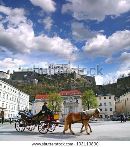 SALZBURG / AUSTRIA - APRIL 16: Horse-drawn carts in the city center April 16, 2006 in Salzburg. In the background of an old fortress.