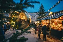 Salzburg Christmas Christkindl advent Market seen trough a Christmas tree branches