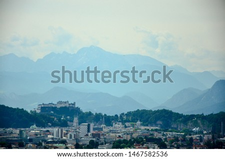Salzburg City and Alps hills in background, white edit space #1467582536