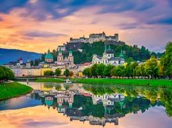 Salzburg sunrise skyline with Festung Hohensalzburg fortress and reflection. Austria