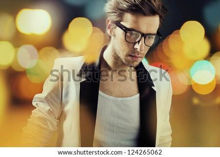 Sam man wearing glasses