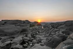 Sam Pan Bok, known as the Grand Canyon of Thailand, is the biggest rock reef in the Mekong River. The natural attraction is located in Ubon Ratchathani Province, Northeastern Thailand. Low tide reveal