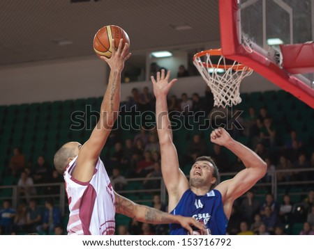 SAMARA, RUSSIA - DECEMBER 05: Andre Smith of BC Krasnye Krylia throws a ball in a basket during a game against BC CSU Asesoft Ploiesti on December 05, 2012 in Samara, Russia.