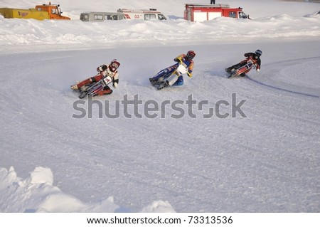 SAMARA, RUSSIA - FEBRUARY 19: A group of unidentified riders compete and train on the Championship Russia winter speedway on Feb. 19, 2011 in Samara, Russia.