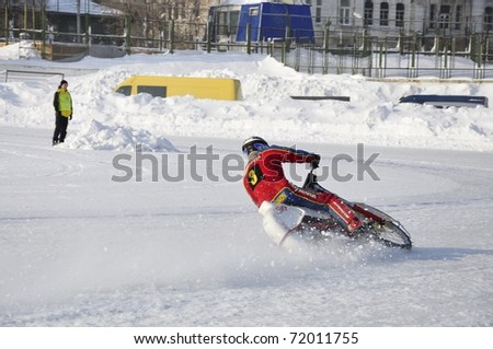 SAMARA, RUSSIA - FEBRUARY 19: Unidentified rider in action during training at Russia speedway championship on February 19, 2011 in Samara, Russia. - stock photo