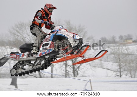 SAMARA, RUSSIA - JANUARY 30: An unidentified rider competes in the Snowcross Russian Championship on January 30, 2011 in Samara, Russia.